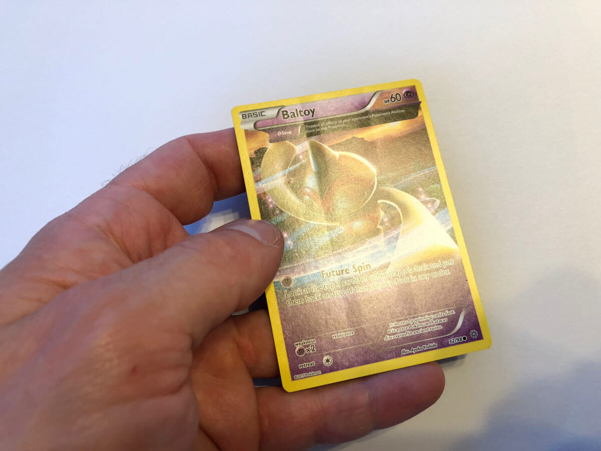 New Pokemon card from factory with crease